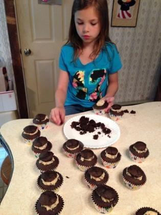 Natasha helping prepare Jessie's bd cupcakes