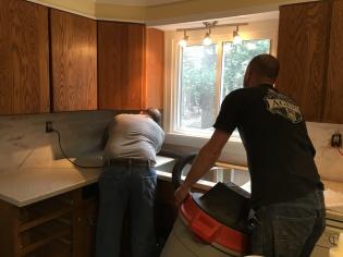Sal and Jonathan installing