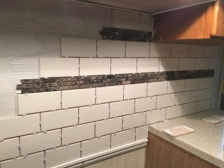Tile and accent strip