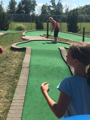 Timothy golfs