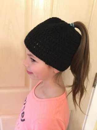 Natasha models pony tail hat